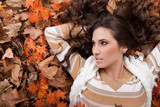 young sexy woman on autumn leaves