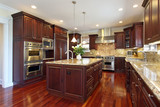 Kitchen with cherry wood cabinetry - 27652536