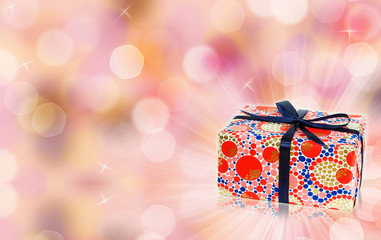 Magic gift box, bokeh and sparkles with free space for text