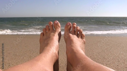 Feet on sandy beach - HD