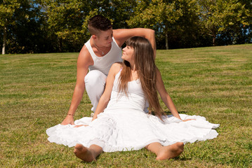 young couple happy sit grass white clothes, love relationship