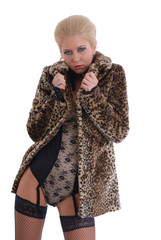 Sexy woman in fur coat and lingerie