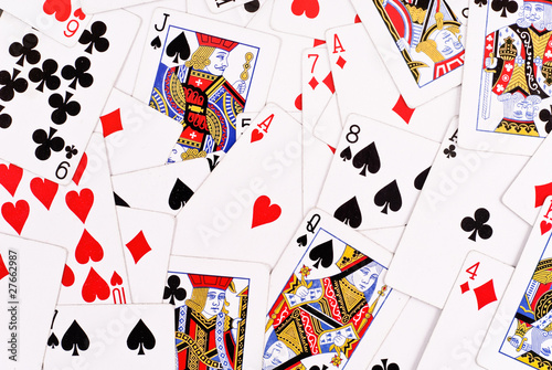Scattered Playing Cards Face Up Background