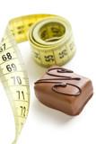 chocolate praline with measuring tape
