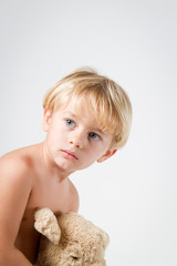 Little boy with stuffed animal