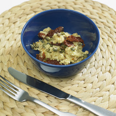 warm couscous salad with dried tomatoes and capers