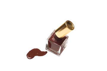 brown nail polish bottle with splatters