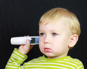Baby boy and digital thermometer