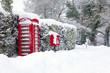 Red telephone and post box in the snow - 27677509