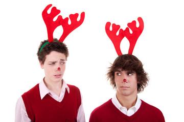 happy young men wearing reindeer horns, admired