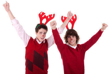 happy young men wearing reindeer horns, with arms raised