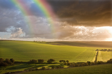 Beautiful Double rainbow over stormy English countryside