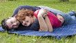 Young Adult Couple Relaxing in the Park