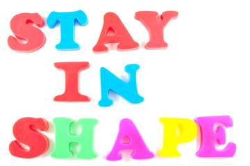 stay in shape written in fridge magnets