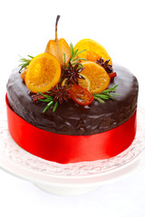 beautiful chocolate cake with glazed fruit isolated on white bac