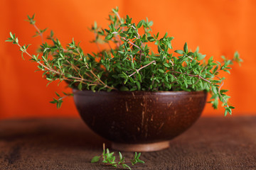 Fresh thyme in a wooden bowl close up