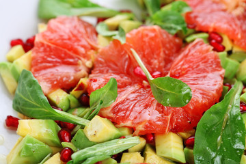 Fresh salad with grapefruit, avocado and pomegranate seeds