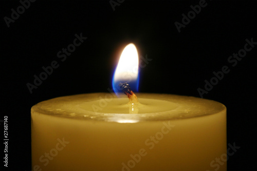 A candle isolated with black background