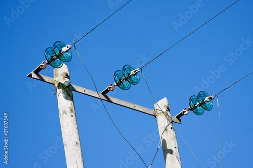 Electricity Poles with Wires and Green Glass Insulators against