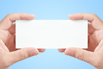 Two hands holding blank paper card
