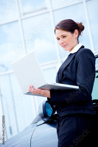 Young business woman outside with notebook