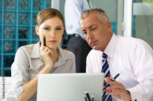 Two colleagues working on laptop