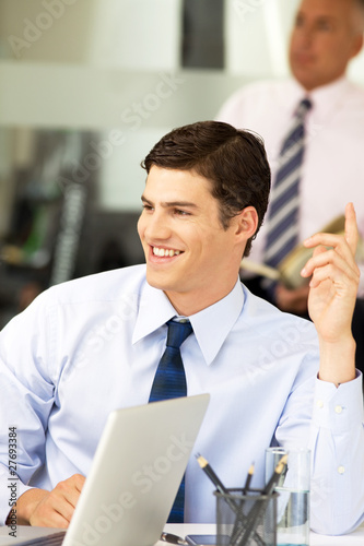 Businessman having a question during a meeting