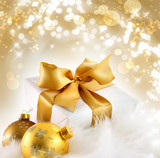 Fototapety Gold ribbon gift with holiday background