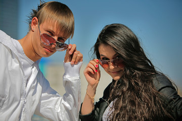 Two young teens on a background of blue sky