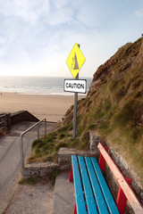 bench and beach landslide caution sign