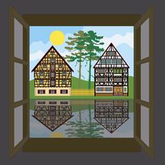 Offenes Fenster mit Blick auf Fachwerkhäuser