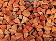 firewood wood pile stacked triangle shape - 27719797