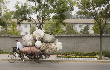 Chinese man on overloaded bike