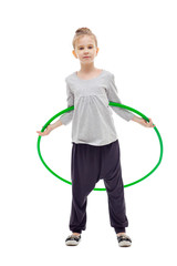 Sporty llittle girl with hula hoop