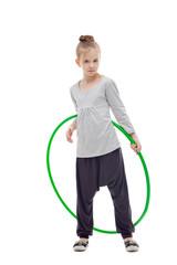 Sporty llittle girl with hula hoop