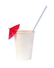 paper cup with a straw and pink cocktail umbrella isolated