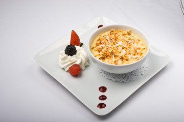 custard with coconut and berries with creme fresh