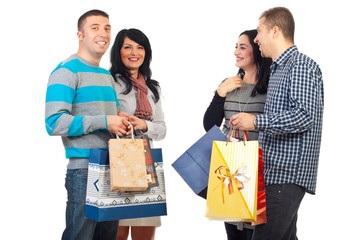 Two couples with shoppings bags