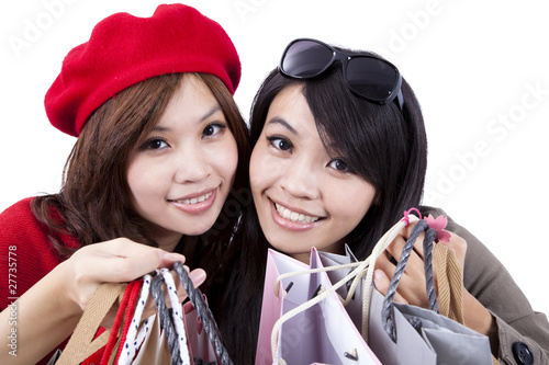 Two Beauty shopping sisters isolated