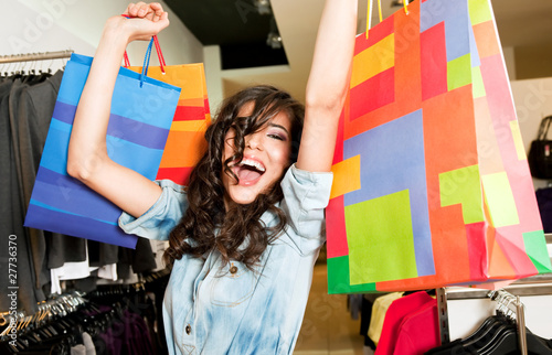 Excited female store bags