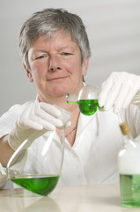 Scientist is working with a green liquid
