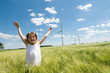 canvas print picture - Girl and Windfarm