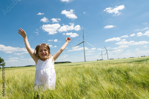 canvas print picture Girl and Windfarm