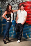 Attractive Young Couple in an Urban Fashion Lifestyle Pose poster