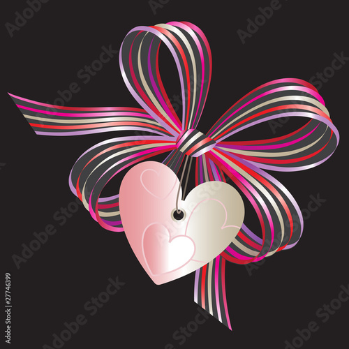 Gift bow with heart-shaped label