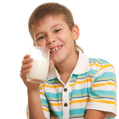 Handsome boy with a glass of milk