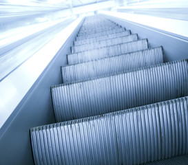 gray steps of escalator in business center