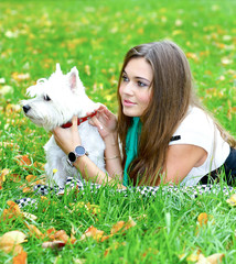 portrait of beautiful girl lying with her dog