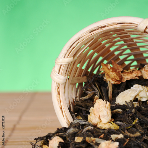 Green jasmine tea in wooden tea strainer