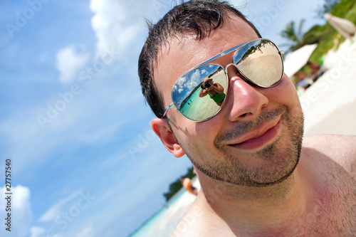 Tropical Beach Vacation - reflection of photographer in lens